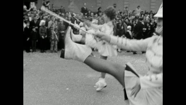 majorettes and marching band in fasching parade, munich; 1966 - musiker stock-videos und b-roll-filmmaterial