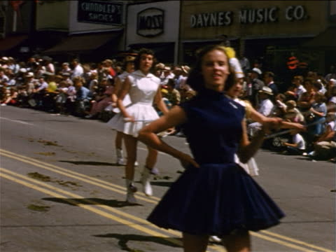 1954 home movie pan majorettes + high school band marching in parade / salt lake city, ut - banda che marcia video stock e b–roll