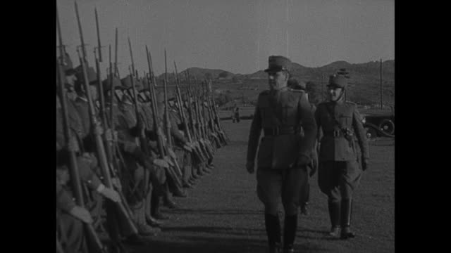 stockvideo's en b-roll-footage met albania majorgeneral sir jocelyn percy tending to potted plants italian officers reviewing troops setting up light artillery infantry drill cu... - benito mussolini