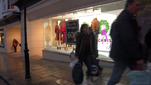 majority of black friday 'deals' cheaper or same price at other times uk surrey guildford high street with christmas lights black friday signs in... - black friday stock videos & royalty-free footage