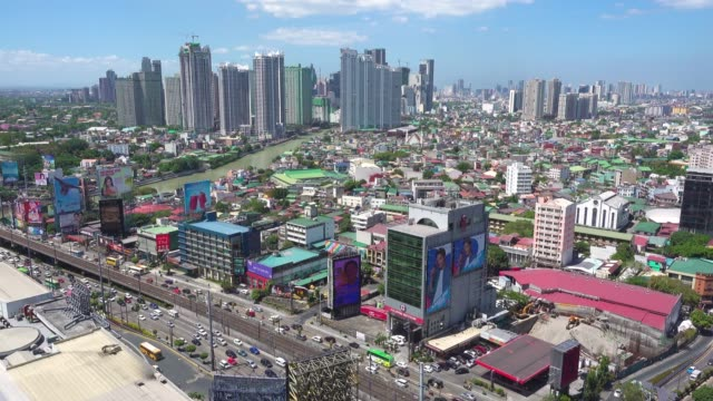 makati manila skyline from high angle point of view. establishing shot with copy space - contrasts stock videos and b-roll footage