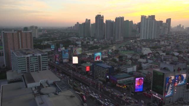 makati manila skyline from high angle point of view. establishing shot with copy space - skyline stock videos & royalty-free footage
