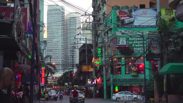 makati nightlife at burgos street and skyscrapers. metro manila, philippines - philippines stock videos & royalty-free footage