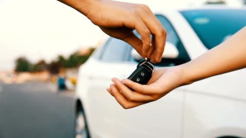 make a deal about buying car,or renting a car - giving stock videos & royalty-free footage