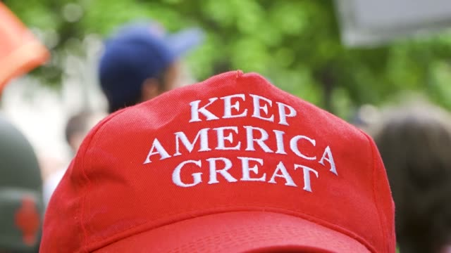 make american great again red hat. members of boston free speech rallied at city hall plaza holding american flags. they claim they are neither white... - baseball cap stock videos & royalty-free footage