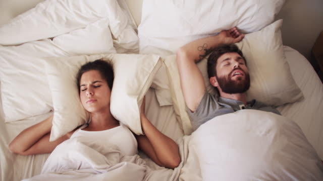 make the snoring stop! - sleep apnea stock videos and b-roll footage