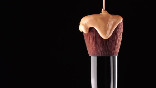 Make up foundation liquid drop on brush