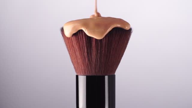 make up foundation liquid drop on brush - blusher make up stock videos and b-roll footage
