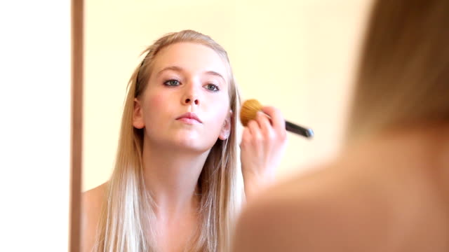 make up video series: woman applying blusher to face - blusher stock videos & royalty-free footage