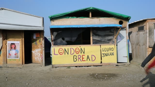 a makeshift bakery in the jungle migrant and refugee camp on october 21 2016 in calais france french authorities are preparing to clear the jungle... - french bakery stock videos & royalty-free footage