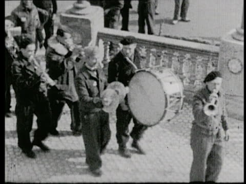 a makeshift marching band performing / a polish soldier dancing on stage for the troops - third reich stock videos and b-roll footage