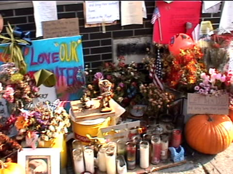 a makeshift memorial at a firehouse near ground zero in the aftermath of the 9/11 terrorist attacks in downtown manhattan - resourceful stock videos & royalty-free footage