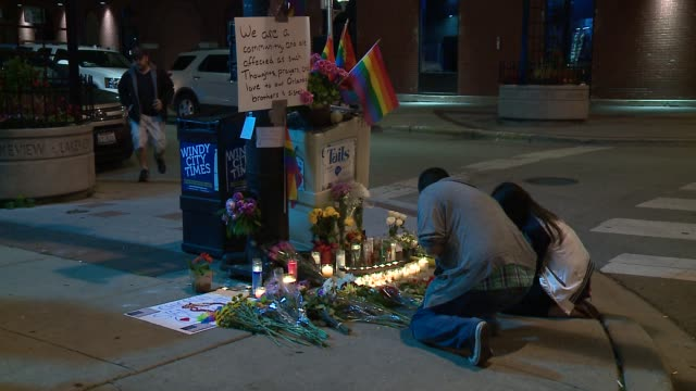 wgn makeshift memorial in chicago's boystown for orlando gay nightclub mass shooting victims on june 13 2016 - memorial stock videos & royalty-free footage