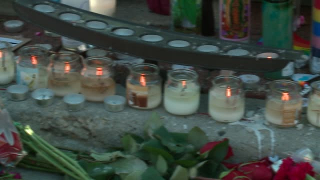 wgn makeshift memorial in chicago's boystown for orlando gay nightclub mass shooting victims on june 13 2016 - homophobie stock-videos und b-roll-filmmaterial