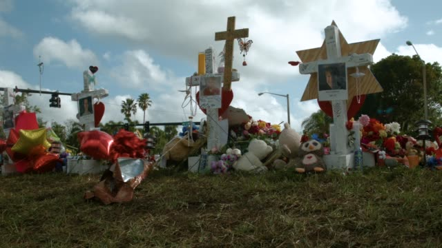 A makeshift memorial is seen setup in front of Marjory Stoneman Douglas High School on February 19 2018 in Parkland Florida Police arrested and...