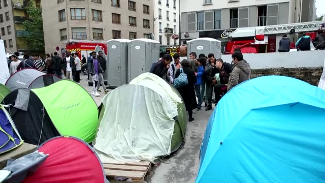 a makeshift refugee camp seen as three refugees diagnosed with tuberculosis in paris france on june 05 2016 - tuberculosis stock videos & royalty-free footage