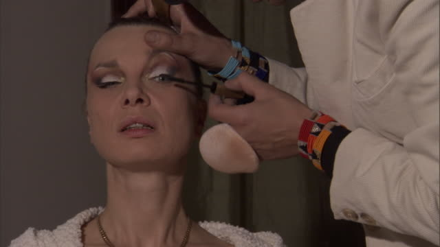 a makeup artist applies mascara to a model's eyelashes. - beautician stock videos & royalty-free footage