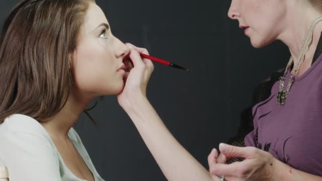 stockvideo's en b-roll-footage met cu tu makeup artist applying eye liner on woman's eye / orem, utah, usa - orem utah