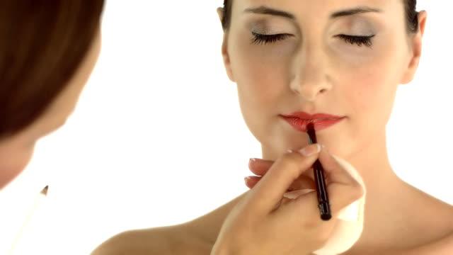 HD: Makeup Artist Applying Lip Gloss