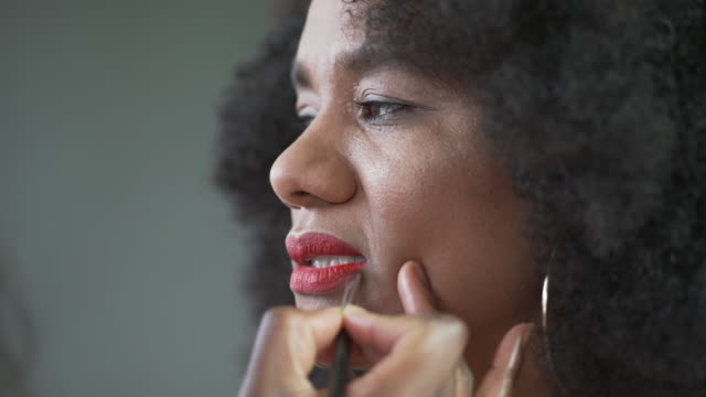 a make-up artist applying red lipstick - red lipstick stock videos & royalty-free footage