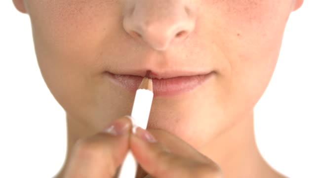 hd: makeup artist lining lips - lip liner stock videos & royalty-free footage