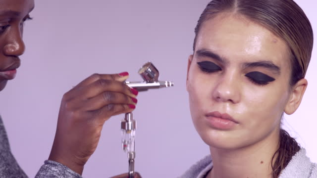 make-up artist using an airbrush - airbrush stock videos & royalty-free footage