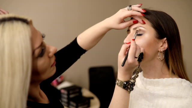 make-up artist work on her friend.real people. - beauty treatment stock videos and b-roll footage