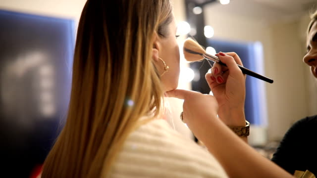 make-up artist work on her friend.real people. - blusher make up stock videos and b-roll footage