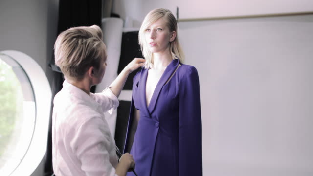 makeup artist working on a model on a photoshoot - artist stock videos & royalty-free footage