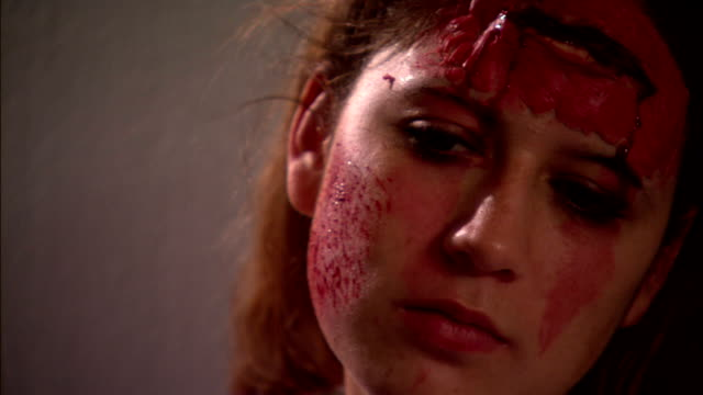 a make-up artists applies graphic make-up that resembles wounds and blood. - gore stock videos & royalty-free footage