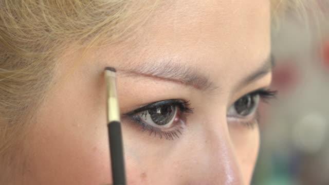 makeup beauty, woman using eyebrow brush