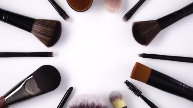 makeup brush rotating on white background - mascara stock videos & royalty-free footage