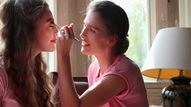 make-up for the wedding day - sister stock videos & royalty-free footage