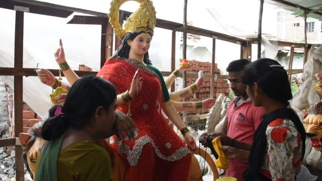makeup of goddess durga idols, maharashtra, india. - drawing artistic product stock videos and b-roll footage