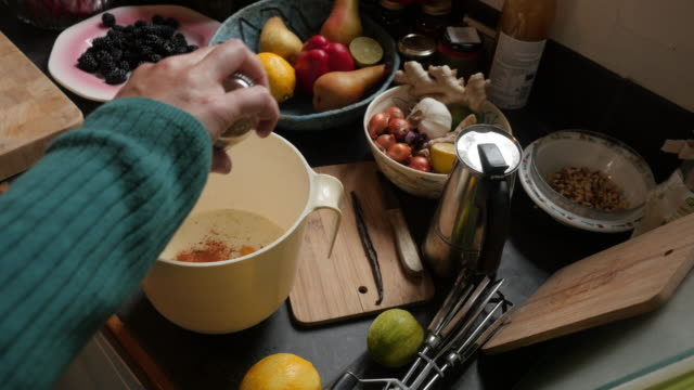 making a blackberry clafoutis: adding ingredients - mixing bowl stock videos and b-roll footage
