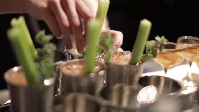 making a cocktail - adding a mint garnish - garnish stock videos & royalty-free footage