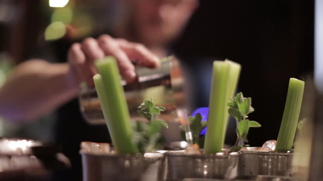 making a cocktail - pouring the cocktail - celery stock videos and b-roll footage