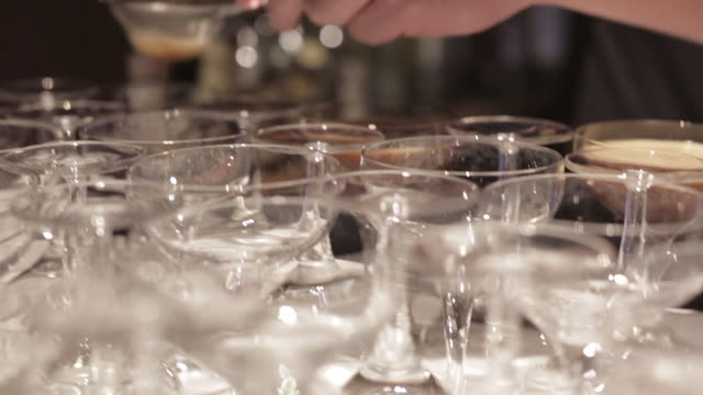 Making a Cocktail - Straining the Cocktail into Glasses