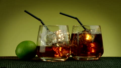 making a cuba libre - rum 'n cola with lime juce - alcohol drink stock videos & royalty-free footage