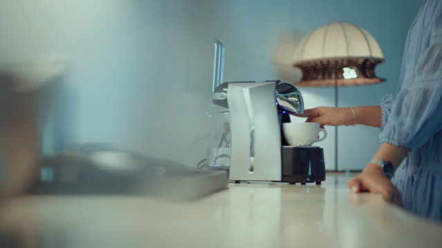 making a cup of coffee with a coffee machine - kitchen worktop stock videos & royalty-free footage