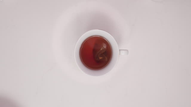 making a cup of tea - tea cup stock videos & royalty-free footage