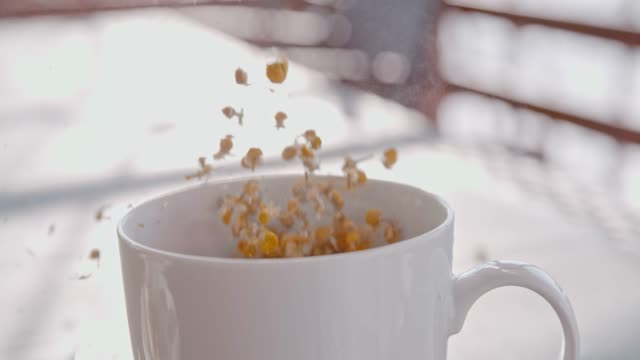 SLO MO Making a cup of tea with dried chamomile flowers
