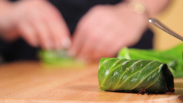 making a dish out of chorizo, apple and cabbage - chorizo stock videos & royalty-free footage