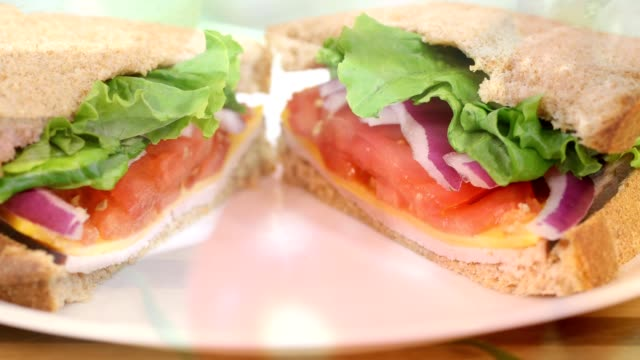 making a ham and cheese sandwich close-up. - making a sandwich stock videos and b-roll footage