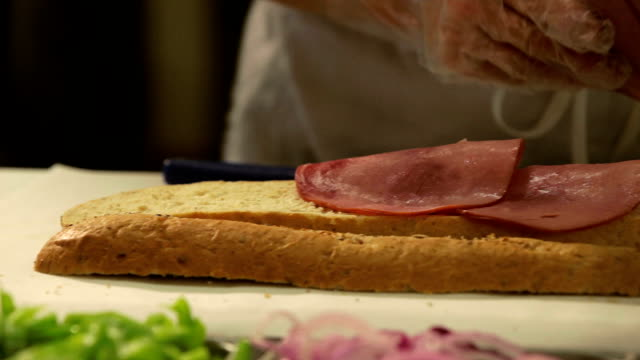making a hoagie sandwich - sandwich stock videos & royalty-free footage