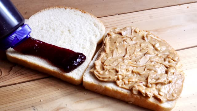making a peanut butter and jelly sandwich - jam stock videos & royalty-free footage