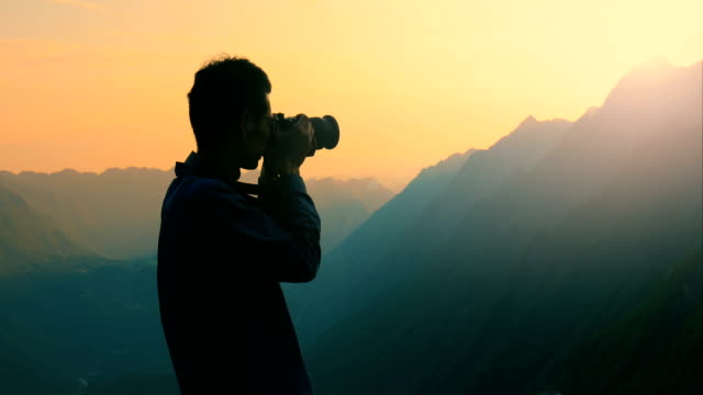 making a photo in the mountains - photo shoot stock videos & royalty-free footage