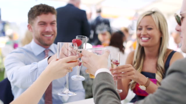 making a race day toast - wealth stock videos & royalty-free footage
