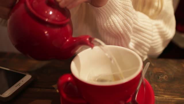 making a refreshing cup of tea - teapot stock videos & royalty-free footage