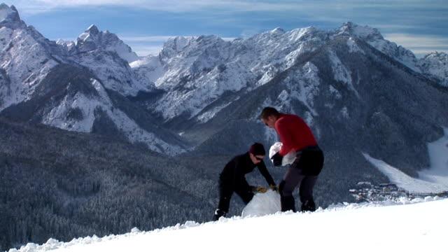 hd: making a snowman - making a snowman stock videos & royalty-free footage